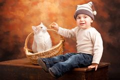 Happy baby boy with a kitten Stock Images