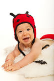 Happy baby boy in ladybug hat Royalty Free Stock Images