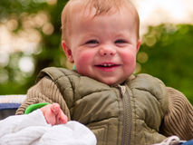 Happy baby boy laughing with joy Stock Photo