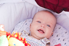 Happy baby boy. Laying in pram Stock Photography