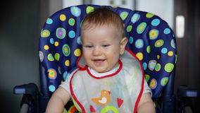 Happy baby boy at lunch time stock video footage