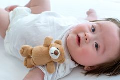 Happy baby boy lying down royalty free stock photography
