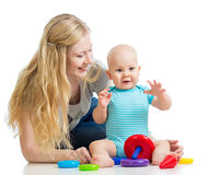 Happy baby boy and mother play together Stock Image