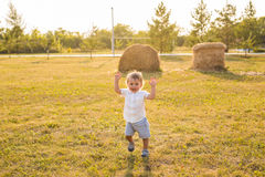 Happy baby boy on natural background in summer. Portrait of smiling happy baby boy on natural background in summer Stock Images