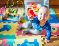 Happy baby boy play. Baby play in his room, cute male baby boy, 8 month old Royalty Free Stock Photos
