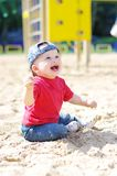 Happy baby boy on playground. Happy baby boy age of 11 months on playground Royalty Free Stock Photography