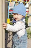 Happy baby boy on playground outdoors. Happy baby boy age of 11 months on playground outdoors Royalty Free Stock Photography