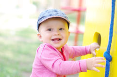 Happy baby boy on playground in summer Royalty Free Stock Photo