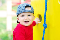 Happy baby boy on playground in summertime Royalty Free Stock Photography