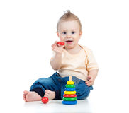Happy baby boy playing with colorful toy Royalty Free Stock Image