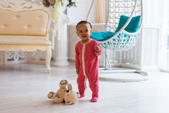 Happy baby boy playing with his teddy bear.  Royalty Free Stock Photos