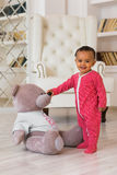 Happy baby boy playing with his teddy bear.  Royalty Free Stock Image