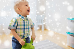 Happy baby boy playing with ride-on toy at home Stock Photography