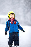 Happy baby boy playing in the snow Stock Photo