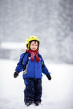 Happy baby boy playing in the snow Royalty Free Stock Photo