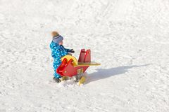 Happy baby boy playing in the snow. Outdoor Royalty Free Stock Photos