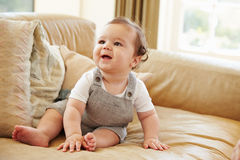 Happy Baby Boy Playing On Sofa At Home Stock Photos
