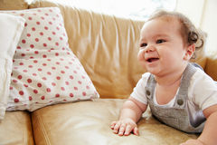 Happy Baby Boy Playing On Sofa At Home Royalty Free Stock Photos