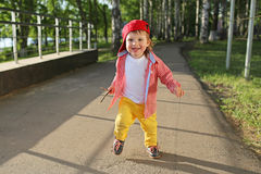 Happy baby boy running outdoors Stock Photo