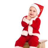 Happy baby boy in santa costume Stock Photos