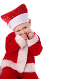 Happy baby boy in santa costume Stock Images