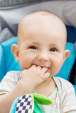 Happy baby boy sitting in a blue stroller Royalty Free Stock Images
