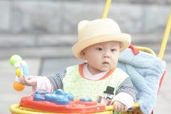 Happy baby boy sitting in stroller Royalty Free Stock Photo