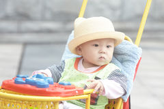 Happy baby boy sitting in stroller Royalty Free Stock Image