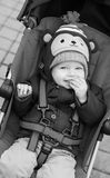 Happy baby boy sitting in a  stroller Royalty Free Stock Photos