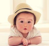 Happy baby boy with straw hat Stock Photos