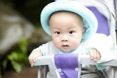 Happy baby boy in stroller Stock Images