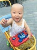 Happy baby boy in stroller Royalty Free Stock Photos
