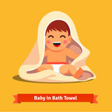 Happy baby boy toddler wrapped in bath towel Royalty Free Stock Photos