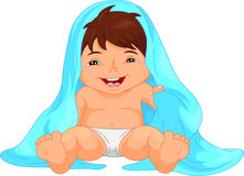 Happy baby boy toddler wrapped in bath towel Stock Photos