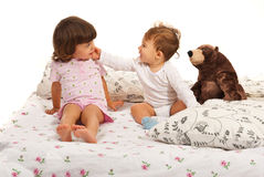 Happy baby boy touching toddler girl Stock Photography