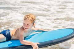 Free Happy Baby Boy - Young Surfer Ride On Surfboard With Fun On Sea Stock Photos - 122350183