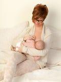 Happy baby breastfeeding stock photo
