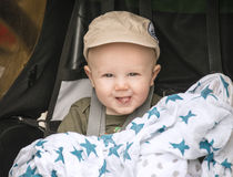 Happy Baby in Cap Goes for a Bike Ride in a Carrier Royalty Free Stock Images