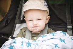 Happy Baby in a Cap Goes for a Bike Ride in a Carrier Stock Image
