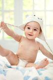 Happy baby with cap. Happy smiling baby with bear cap Stock Images