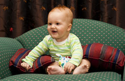 Happy baby on chair Royalty Free Stock Photography