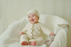 Happy baby on the chair Royalty Free Stock Photo