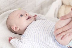 Happy baby on changing table Stock Photos