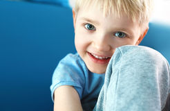 Happy baby, cheerful baby. Portrait of a laughing little boy Stock Image