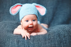 Happy baby child in costume a rabbit bunny   on a grey. Background Royalty Free Stock Photo