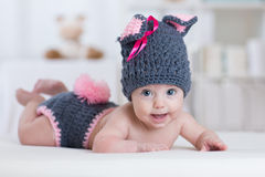 Happy baby child in costume a rabbit bunny Stock Image