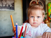 Happy baby child draws with colored pencils crayons Stock Photography