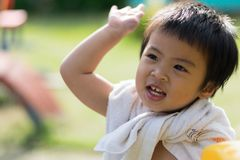 Happy baby child at the playground. stock photos