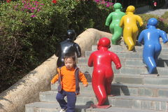 Happy baby and child statue in the Shenzhen International Garden and Flower Expo Park Royalty Free Stock Image