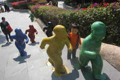 Happy baby and child statue in the Shenzhen International Garden and Flower Expo Park Stock Image